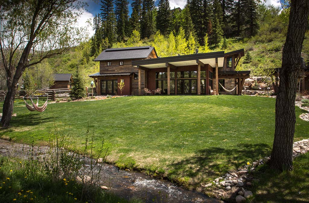 exterior backyard of luxury mountain home in steamboat springs by gerber berend design build