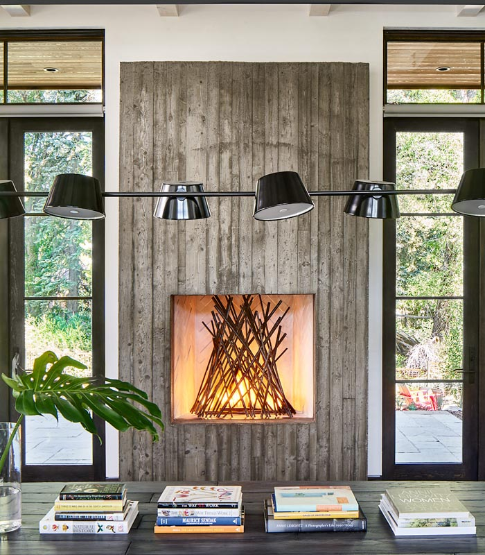 abstract fireplace and industrial lighting by gerber berend custom design builds