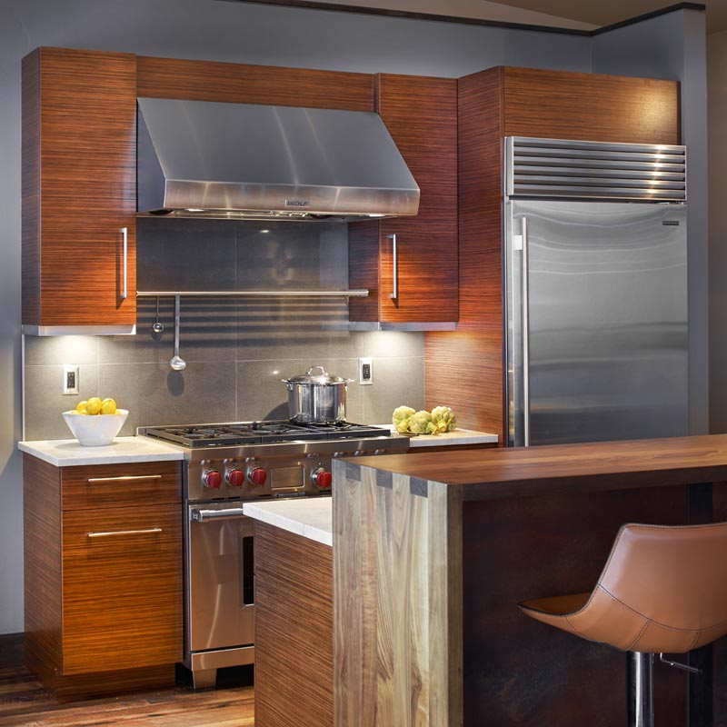 stainless hood and modern appliances in luxury custom home by gerber berend design build