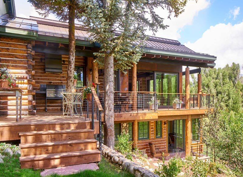 downtown steamboat hideaway log home deck by gerber berend design build