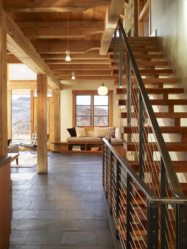 custom open stairway sunlit living room comforting architecture