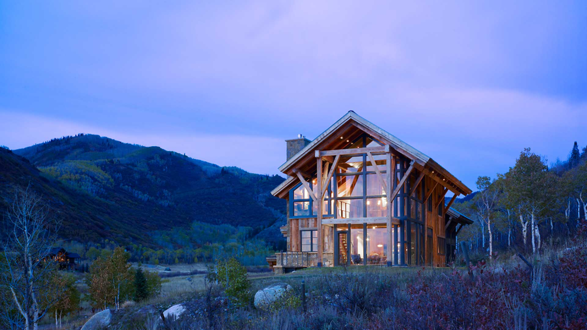 glass walls exterior custom home at dusk steamboat springs colorado