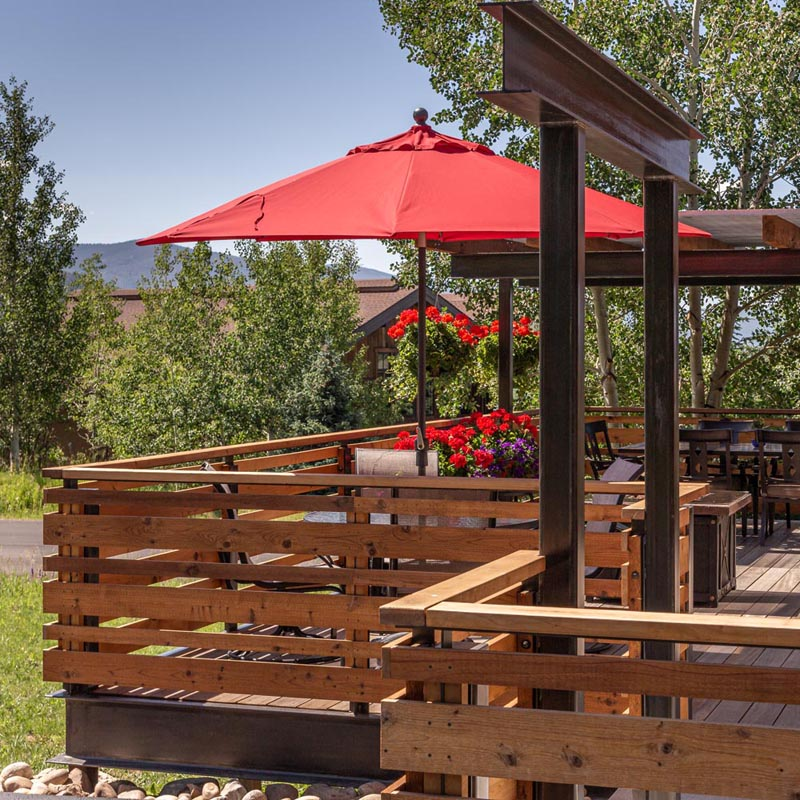 steamboat springs luxury custom deck in the summer built by gerber berend design build