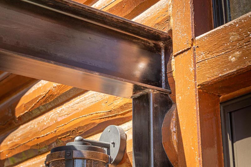deck framing and i-beam built into fascia of custom log home by gerber berend