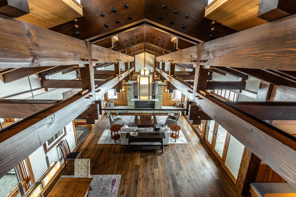 extraordinary wood beams in great room of custom home