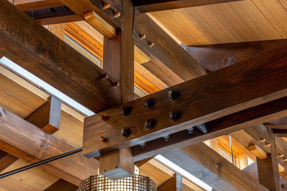 custom detailed woodworking on beams and ceiling architecture